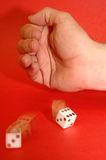 Hand rolling dice for gambling or gaming Stock Photo