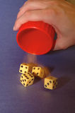 Hand rolling dice for gambling or gaming Royalty Free Stock Images