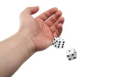 Hand Rolling Dices. Isolated on White Background royalty free stock photo