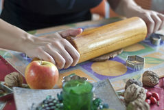 Hand rolling out dough with rolling pin Royalty Free Stock Images