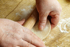 Hand with rolling pin and flour Royalty Free Stock Image