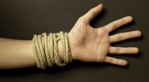 Hand with a rope with black background Stock Photo