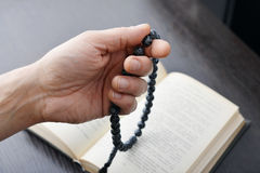 Hand with rosary beads Royalty Free Stock Images