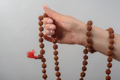Hand with a rosary stock images