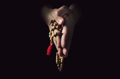 Hand with a rosary isolated on white background royalty free stock images