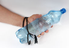 Hand with rosary and water Royalty Free Stock Images