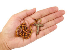 Hand with rosary  on a white background Royalty Free Stock Image