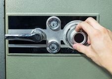 Hand rotate safe lock security Stock Photo