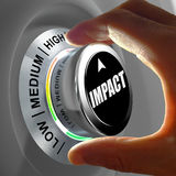 Hand rotating a button and selecting the level of impact. This concept illustration is a metaphor for estimating the level of impact. Three levels are Stock Image