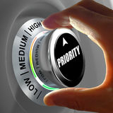Hand rotating a button and selecting the level of profit. Hand rotating a button and selecting the level of priority. This concept illustration is a metaphor Royalty Free Stock Images