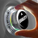 Hand rotating a button and selecting the level of quality. This concept illustration is a metaphor for choosing the level of quality. Three levels are Royalty Free Stock Photos