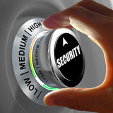 Hand rotating a button and selecting the level of security. This concept illustration is a metaphor for choosing the level of security. Three levels are Royalty Free Stock Photo