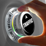 Hand rotating a button and selecting the level of traffic. This concept illustration is a metaphor for choosing the level of traffic (web site, car...) . Three Stock Image