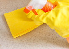 Hand in rubber glove cleans a new kitchen Royalty Free Stock Photo
