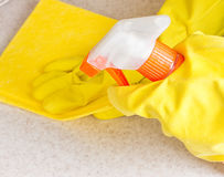 Hand in rubber glove cleans a new kitchen Stock Images