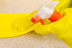 Hand in rubber glove cleans a new kitchen Royalty Free Stock Photos