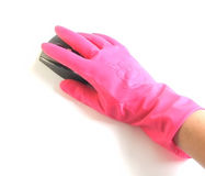 Hand in rubber glove with a computer mouse Royalty Free Stock Photos
