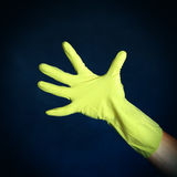 Hand in Rubber Glove Stock Images