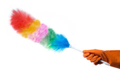 Hand in rubber glove with a duster on white Royalty Free Stock Photos