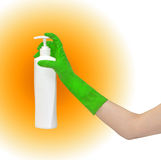 Hand in rubber glove holding cleaning product Royalty Free Stock Photos