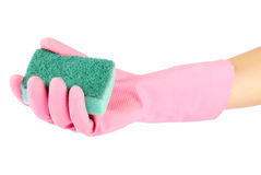 Hand in rubber glove holding a kitchen sponge Stock Photos