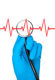 Hand in rubber glove holding stethoscope. Stock Image