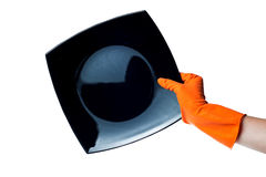 Hand in rubber glove with a plate on white Stock Image