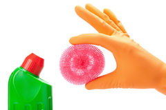 Hand in rubber glove with scrub pad and bottles Royalty Free Stock Photo