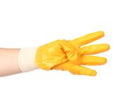 Hand in rubber glove showing four. Stock Photos