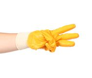 Hand in rubber glove showing three. Stock Photos