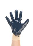 Hand in rubber glove shows five. Stock Photo