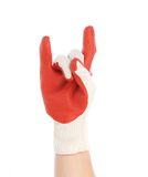 Hand in rubber glove shows rock sign. Stock Image