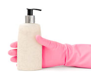 Hand in Rubber Housework Glove Gripping a Bottle of Cosmetic Lot Royalty Free Stock Image