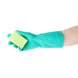 Hand in rubber latex glove holding kitchen sponge over white isolated background Royalty Free Stock Photo
