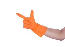 Hand with rubber orange glove Royalty Free Stock Images