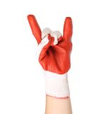 Hand in rubber protective glove shows rock sign Royalty Free Stock Images