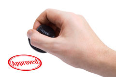 Hand and rubber stamp Approved royalty free stock photo