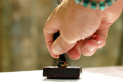 Hand and rubber stamp Royalty Free Stock Photo