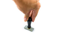 Hand and rubber stamp on white background. Hand and rubber stamp on white Royalty Free Stock Photography