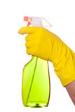 Hand in rubber yellow glove holding green plastic dispenser isol Royalty Free Stock Images