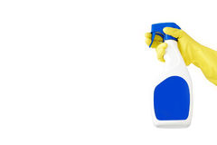 Hand in rubber yellow glove holds  spray bottle of liquid detergent on white background. cleaning Stock Photography