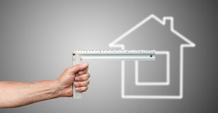Hand with ruler and house Stock Photos