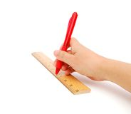 Hand with ruler and pen Stock Photography