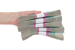 Hand with russian roubles bills over white background Royalty Free Stock Images
