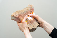 Hand with russian roubles bills  on white background Royalty Free Stock Photo