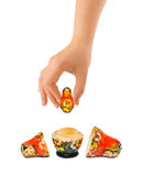 Hand and russian toy matrioska. Isolated on white background Stock Photo