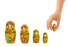 Hand and russian toy matrioska. Isolated on white background Royalty Free Stock Images