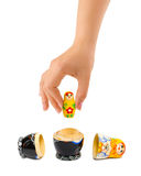 Hand and russian toy matrioska. Isolated on white background Royalty Free Stock Photo
