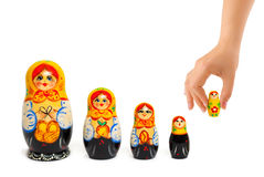Hand and russian toy matrioska. On white background Stock Image