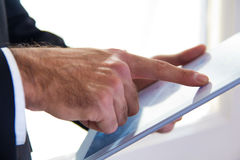 Hand's detail of Businessman using a digital tablet Royalty Free Stock Photos